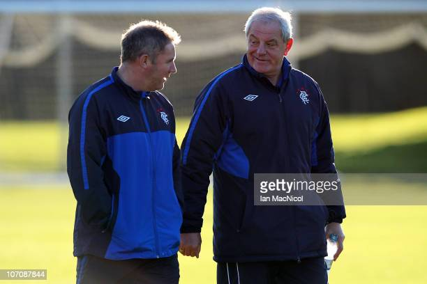 Walter Smith manager of Glasgow Rangers and assistant coach Ally McCoist chat during training at Murray Park prior to tomorrow night's UEFA Champions...