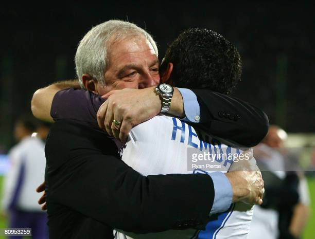 Walter Smith, manager of of Ranger, celebrates with Brahim Hemdani of Rangers after the UEFA Cup Semi Final second leg match at the Artemio Franchi...