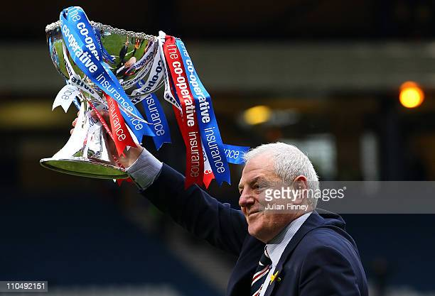 Walter Smith manager of Rangers with the winners trophy during the Cooperative Insurance Cup final between at Hampden Park on March 20 2011 in...