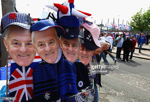 Walter Smith masks are sold as Rangers fans arrive at the stadium for the Clydesdale Bank Premier League match between Rangers and Hearts at Ibrox...