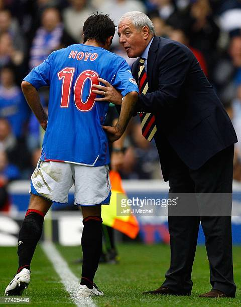 Walter Smith talks with Nacho Novo of Rangers during the Scottish Premier League match between Rangers and Celtic at Ibrox Stadium on October 20 2007...