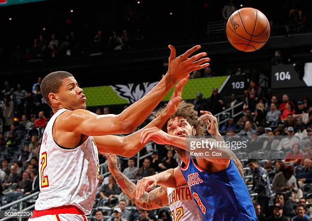 Walter Tavares of the Atlanta Hawks battles for a rebound against Robin Lopez of the New York Knicks at Philips Arena on January 5 2016 in Atlanta...