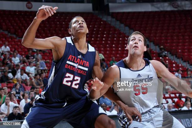 Walter Tavares of the Atlanta Hawks battles for position against Daniel Miller of the Washington Wizards at the Samsung NBA Summer League 2014 on...