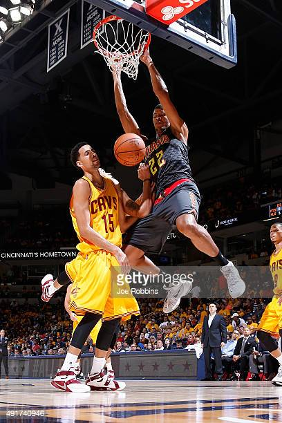 Walter Tavares of the Atlanta Hawks dunks against Austin Daye of the Cleveland Cavaliers in the second half of a preseason game at Cintas Center on...