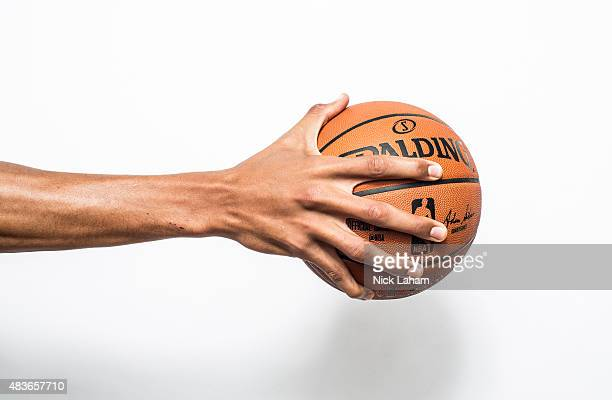 Walter Tavares of the Atlanta Hawks palms a basketball for a portrait during the 2015 NBA rookie photo shoot on August 8 2015 at the Madison Square...