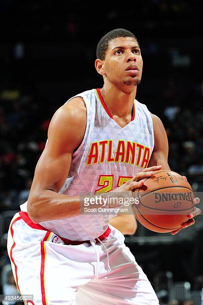 Walter Tavares of the Atlanta Hawks shoots a foul shot against the San Antonio Spurs during a preseason game on October 14 2015 at Philips Arena in...