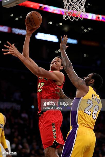 Walter Tavares of the Atlanta Hawks shoots over Tarik Black of the Los Angeles Lakers during the second half of a game at Staples Center on March 4...