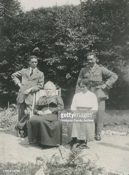 Walter Tull in his officer uniform with his brother Edward and sister Cissie and Edward's adoptive mother, Jean Warnock, on holiday at Garelochhead,...