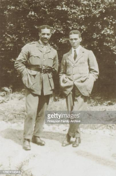 Walter Tull in his officer's uniform is standing with his older brother Edward, while the family are on holiday at Garelochhead in Scotland in 1917....