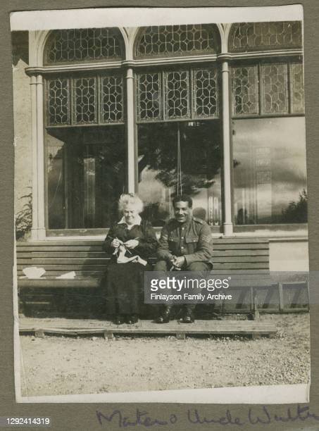 Walter Tull in his officer's uniform with Jean Warnock, his brother Edward's Glaswegian adoptive mother, on holiday at Garelochhead in Scotland....