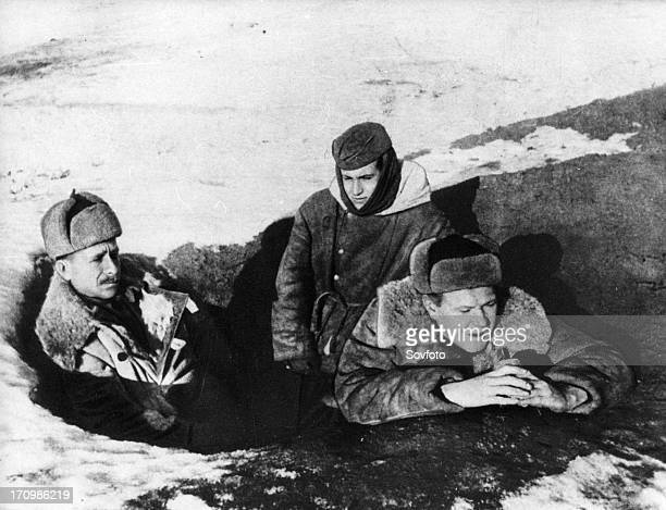 Walter ulbricht and erich weinert talk to german soldiers on the front line facing stalingrad during world war 2.