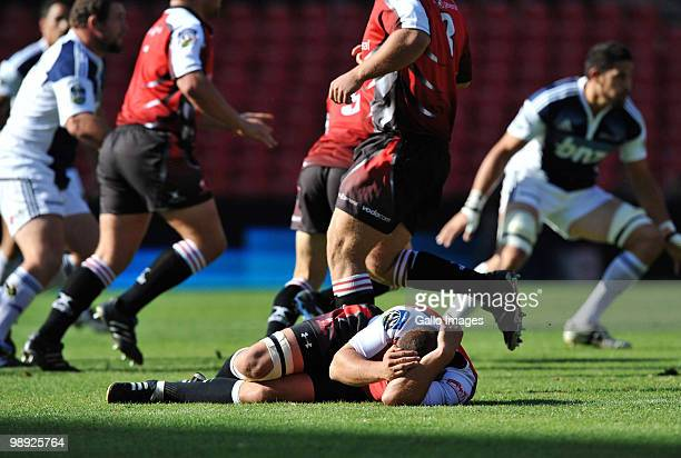 Walter Venter of the Lions lies injured during the Super 14 match between Auto and General Lions and Blues at Coca Cola Park on May 08 2010 in...