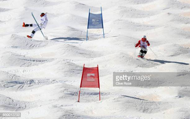 Walter Wallberg of Sweden crashes with Ikuma Horishima of Japan during Men's Dual Moguls Qualification on day two of the FIS Freestyle Ski and...