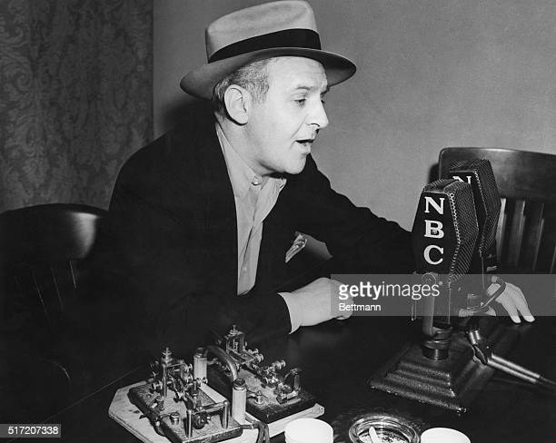 Walter Winchell newspaper columnist and radio reporter at microphone