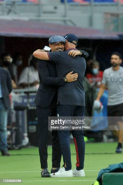 Walter Zenga head coach of Cagliari Calcio shares a hug with Sinisa MIhajlovic head coach of Bologna FC prior the beginning of the Serie A match...