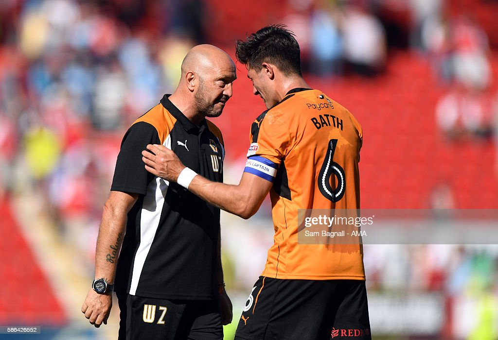 Walter Zenga manager / head coach of Wolverhampton Wanderers and Danny Batth of Wolverhampton Wanderers at full time during the Sky Bet Championship match between Rotherham United v Wolverhampton Wanderers at The New York Stadium on August 6, 2016 in Rotherham, England.