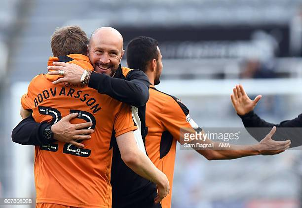 Walter Zenga manager / head coach of Wolverhampton Wanderers celebrates at full time with Jon Dadi Bodvarsson of Wolverhampton Wanderers during the...