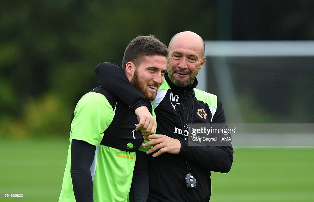 Walter Zenga manager / head coach of Wolverhampton Wanderers shares a joke with Matt Doherty during a training session at Compton on August 22, 2016 in Wolverhampton, England.