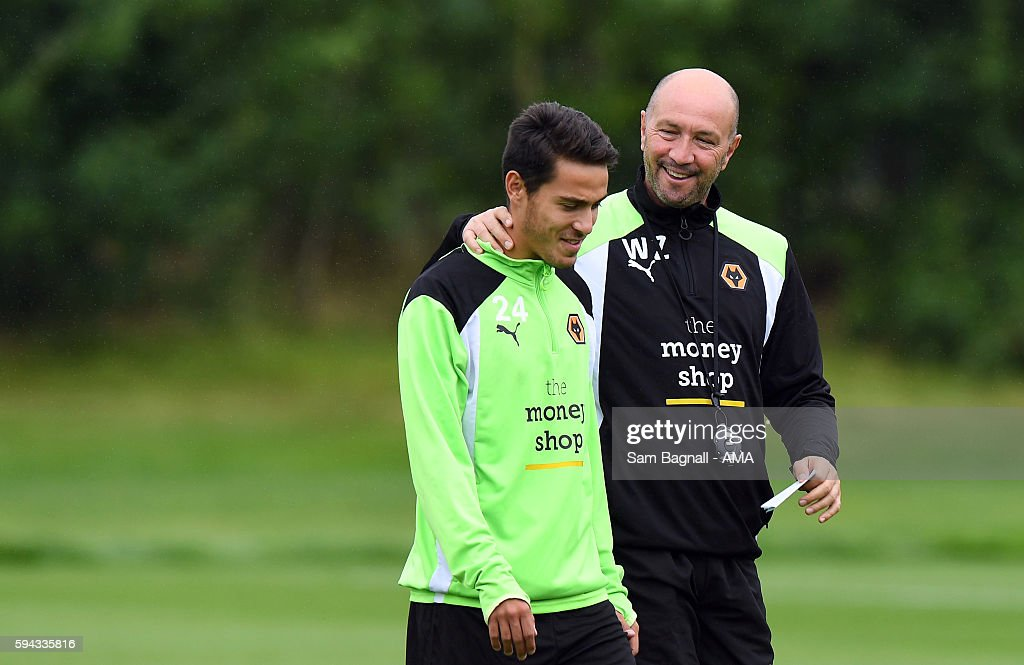 Walter Zenga manager / head coach of Wolverhampton Wanderers shares a joke with Joao Teixeira of Wolverhampton Wanderers during a training session at Compton on August 22, 2016 in Wolverhampton, England.