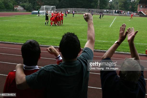 Walton and Hersham fans celebrate Eben Allen's goal against Dulwich Hamlet during the FA Cup 1st qualifying round match at Stompond Lane...