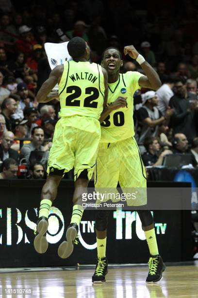 Walton and Quincy Miller of the Baylor Bears show camaraderie in the second half of the game against the Colorado Buffaloes during the third round of...