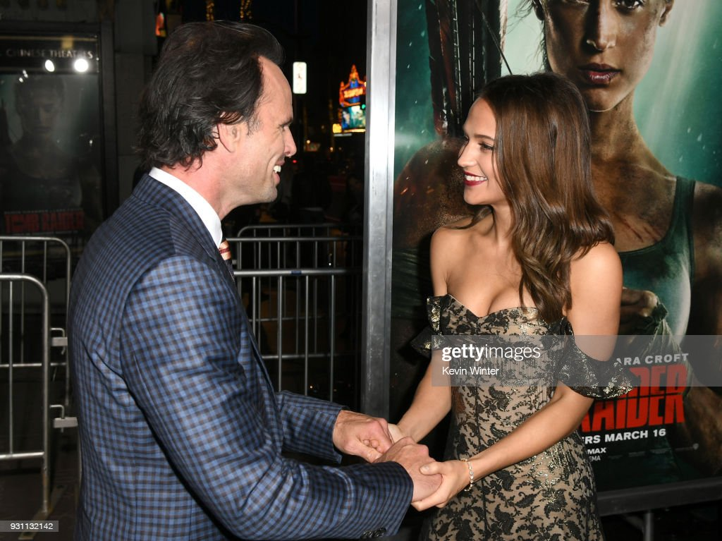 Walton Goggins (L) and Alicia Vikander attend the premiere of Warner Bros. Pictures' 'Tomb Raider' at TCL Chinese Theatre on March 12, 2018 in Hollywood, California.
