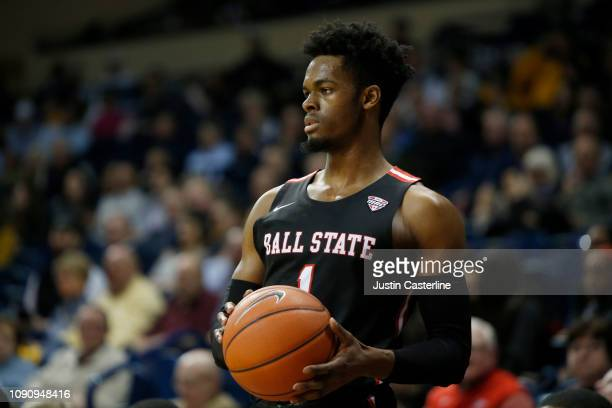 J Walton of the Ball State Cardinals looks to pass the ball in the game against the Toledo Rockets during the second half at Savage Arena on January...