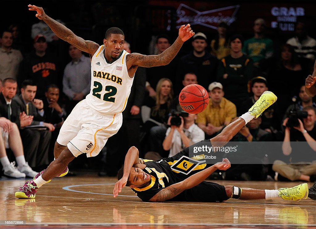 A.J. Walton #22 of the Baylor Bears and Roy Devyn Marble #4 of the Iowa Hawkeyes pursue the loose ball during the 2013 NIT Championship at Madison Square Garden on April 4, 2013 in New York City. Baylor defeated Iowa 74-54.