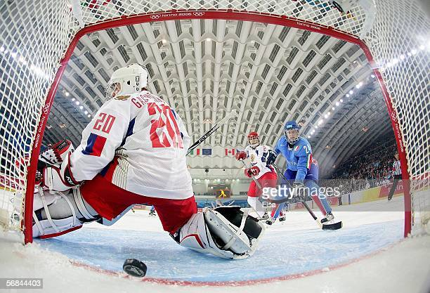 Waltraud Kaser of Italy watches a goal scored by teammate Sabina Florian get past goalie Irina Gashennikova of Russia in the first period of the...