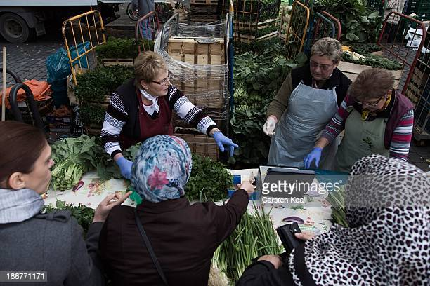 Waltraut Schulz Ingrid Witte and Giesela Zuelz sell cabbage leaves to Muslim women at the semiweekly outdoor market at Maybachufer in Kreuzberg...