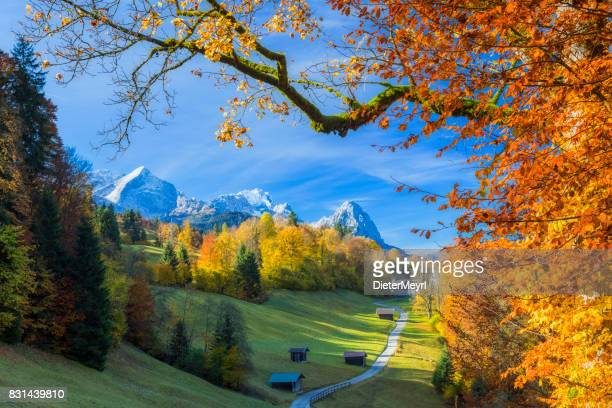 wamberg, the highest village with church in germany at autumn - bavaria stock pictures, royalty-free photos & images
