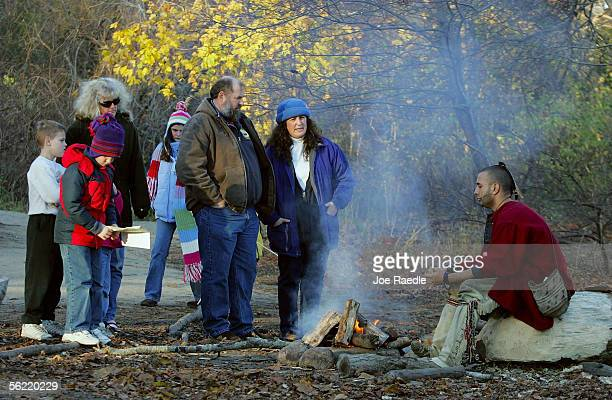 Wampanoag Indian speaks with visitors at the Wampanoag Homesite near the 1627 Pilgrim Village at Plimoth Plantation where they and other roleplayers...