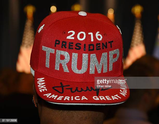 Wan Ali of Nevada wears a Donald Trump hat during a caucus night watch party for Republican presidential candidate Donald Trump at the Treasure...