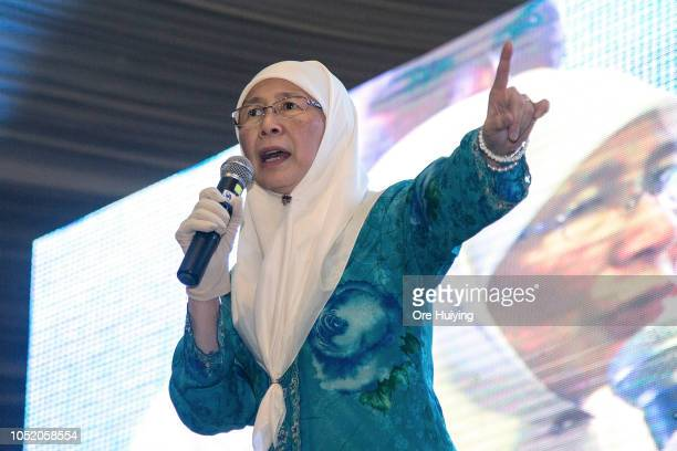 Wan Azizah PKR president Malaysia's Deputy Prime Minister and wife of Anwar Ibrahim speaks to his supporters outside the party's headquarters after...