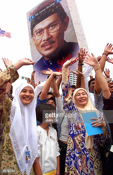 Wan Azizah Wan Ismail the wife of Malaysia's jailed former deputy premier Anwar Ibrahim and her daughters Nurul Izzah and Nurul Hana together with...