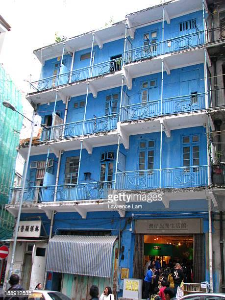 Wan Chai traditional looking Blue House in Hong Kong. In this photo, an exhibit of the Hong Kong tram is being hosted to celebrate its 100th...