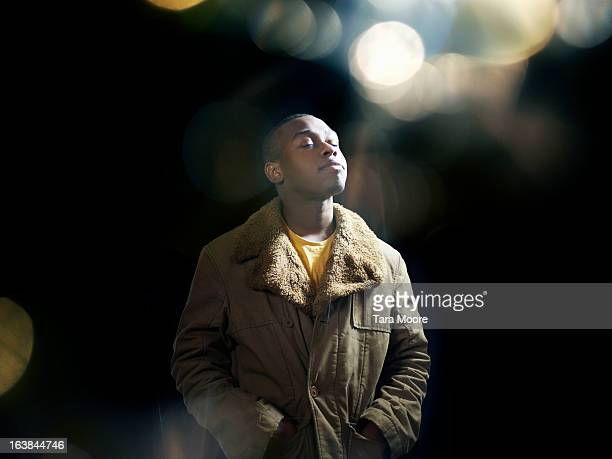 wan with eyes closed dreaming at night - lens flare stock pictures, royalty-free photos & images