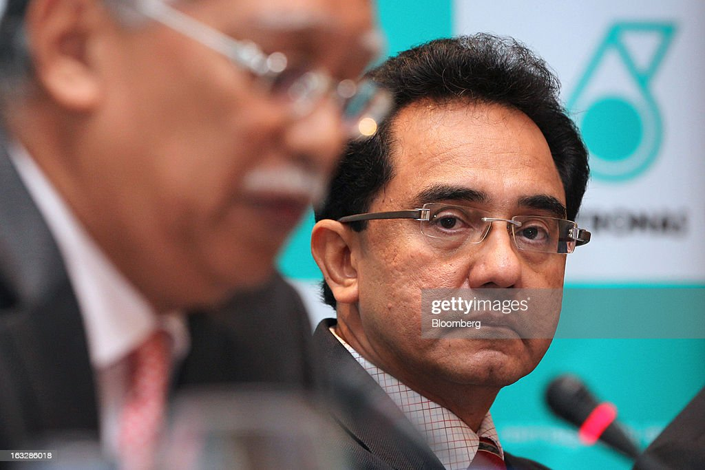Wan Zulkiflee Wan Ariffin, chief operating officer of Petroliam Nasional Bhd. (Petronas), right, and Shamsul Azhar Abbas, chief executive officer of Petronas, attend a news conference in Kuala Lumpur, Malaysia, on Thursday, March 7, 2013. Petronas, Malaysia's state energy company, defended its 8.8 billion ringgit ($2.8 billion) buyout offer price for MISC Bhd. after criticism from minority shareholders that it's too low. Photographer: Goh Seng Chong/Bloomberg via Getty Images