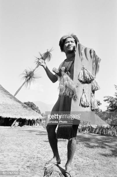 Wancho tribal in traditional attire and holding spear in Tirap district, Arunachal Pradesh, India 1982