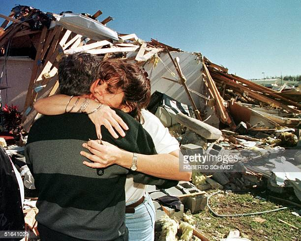 Wanda Aviles hugs her father Victor as they meet in front of their destroyed home in the Flamingo Lakes residential community in Kissimmee Florida 24...