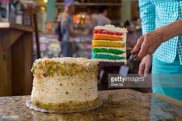 Wanda Beaver of Wanda's Pie in the Sky shows off the pride month themed cookies rainbow cakes and cup cakes being sold from the shop in Kensington...