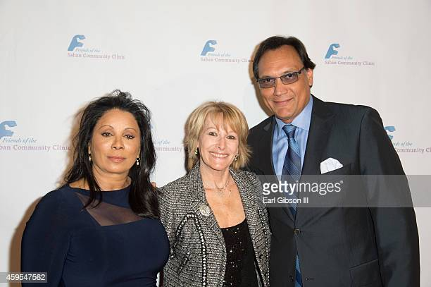Wanda De Jesus Ellen Hoberman Jimmy Smits pose for a photo on the red carpet at The Saban Clinic 38th Annual Dinner Gala at The Beverly Hilton Hotel...