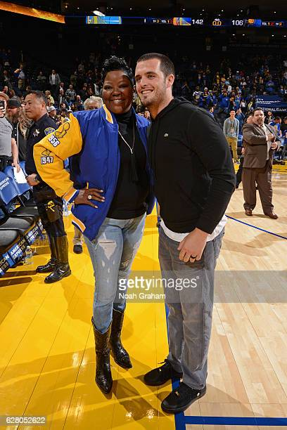 Wanda Durant greets Oakland Raider Derek Carr after the Indiana Pacers game against the Golden State Warriors on December 5 2016 at ORACLE Arena in...