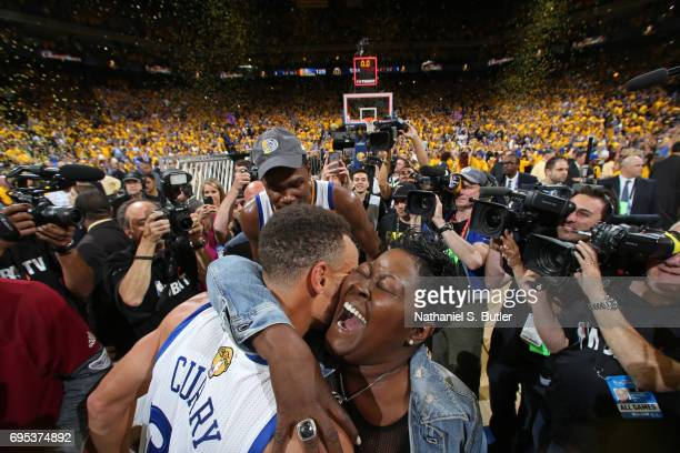 Wanda Durant hugs Stephen Curry of the Golden State Warriors after winning Game Five of the 2017 NBA Finals against the Cleveland Cavaliers on June...