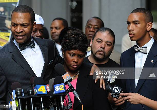 Wanda Johnson the mother of Oscar J Grant III is comforted by her supporters outside the Los Angeles Superior Court after the involuntary...