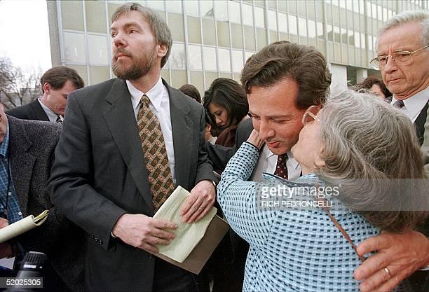 Wanda Kaczynski mother of Theodore Kaczynski kisses attorney Anthony Pisceglie beside her son David Kaczynski outside the Federal Courthouse 22...