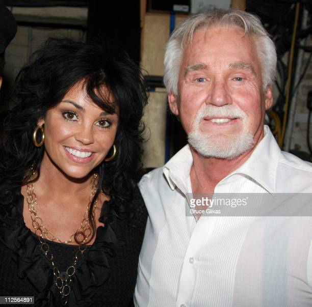 COVERAGE*** Wanda Miller and husband Kenny Rogers pose as they visit backstage at Hairspray on Broadway at The Neil Simon Theater on December 13 2007...