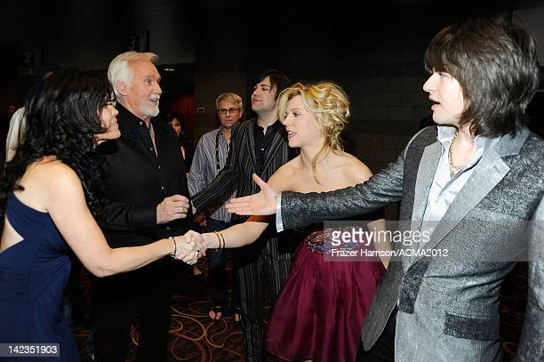 Wanda Miller and Kenny Rogers meet Neil Perry Kimberly Perry and Reid Perry of the Band Perry at the Lionel Richie and Friends in Concert presented...