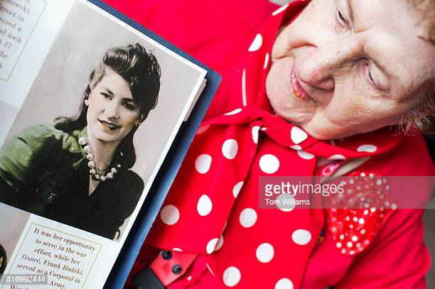 Wanda Rudzki a World War II era Rosie the Riveter poses with a early picture of herself during a lunch at the Library of Congress March 22 2016...