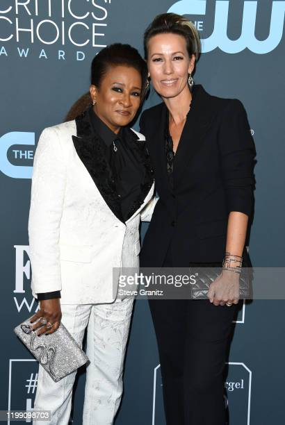 Wanda Sykes and Alex Sykes attend the 25th Annual Critics' Choice Awards at Barker Hangar on January 12 2020 in Santa Monica California